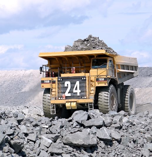 A Mega truck carrying load of rocks at a mining site